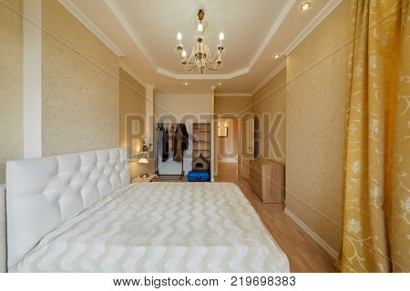 Interior of modern room with double bed in flat.