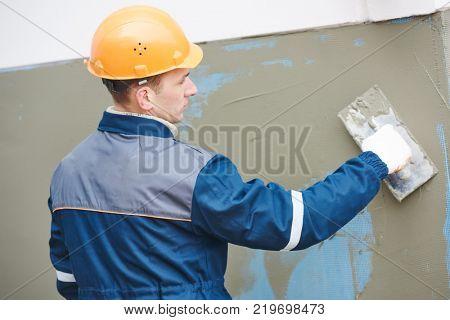 Facade work. Fiberglass reinforcing plastering mesh used for plaster work
