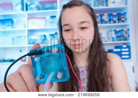 schoolgirl is experimenting with a hydrogen fuel cell