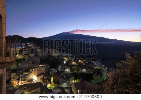 night view Castiglione di Sicilia village and Etna Mount at twilight, Sicily