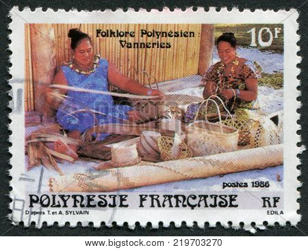 FRENCH POLYNESIA - CIRCA 1986: Postage stamps printed in French Polynesia depicts a woman weaving a basket weaving circa 1986