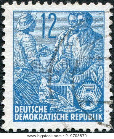 DDR - CIRCA 1953: A stamp printed in DDR shown Worker peasant and intellectual circa 1953