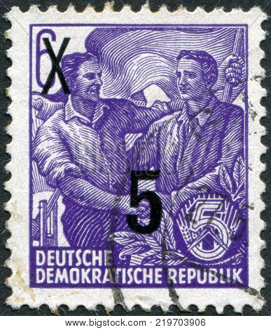 DDR - CIRCA 1953: A stamp printed in DDR shows the German and Soviet workers shake hands (overprint 1954) circa 1953
