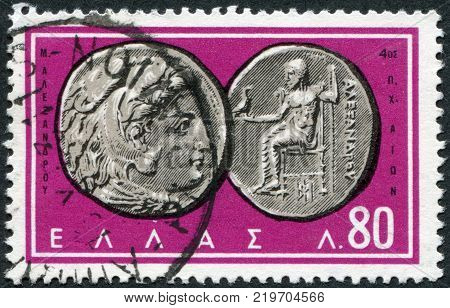GREECE - CIRCA 1963: A stamp printed in Greece shows the ancient Greek coins Alexander the Great Zeus Hercules circa 1963