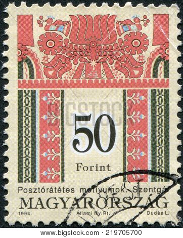 HUNGARY - CIRCA 1994: A stamp printed in Hungary is depicted Folk Designs circa 1994