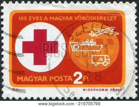 HUNGARY - CIRCA 1981: A stamp printed in Hungary is devoted to 100 anniversary of the Hungarian Red Cross shows the Red Cross and Ambulance Vehicles circa 1981