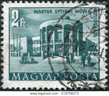 HUNGARY - CIRCA 1953: A stamp printed in Hungary is depicted Optical works house of culture circa 1953