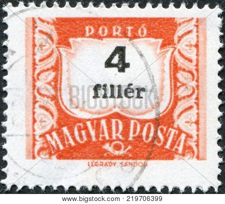 HUNGARY - CIRCA 1958: A stamp printed in Hungary is depicted porto-mark a shield face value 4 filler circa 1958
