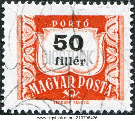 HUNGARY - CIRCA 1958: A stamp printed in Hungary is depicted porto-mark a shield face value 50 filler circa 1958