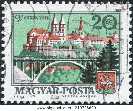 HUNGARY - CIRCA 1973: A stamp printed in Hungary depicts town Veszprem viaduct and coat of arms circa 1973