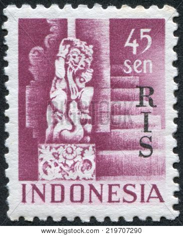 INDONESIA - CIRCA 1950: A stamp printed in the Indonesia shows the sculpture of the god Shiva from Temple at Bedjoening Bali. Overprint RIS (Netherlands Indies) circa 1950