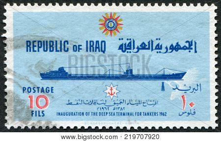 IRAQ - CIRCA 1965: A stamp printed in the Iraq is dedicated to ending the construction of a deepwater port at Basra. Depicts an oil tanker circa 1965