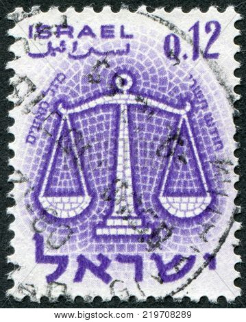 ISRAEL - CIRCA 1961: A stamp printed in the Israel, depicts sign of the zodiac Scales, circa 1961