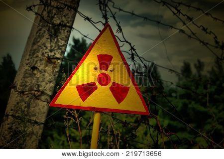 Hazard. Radioactive sign in the ruins