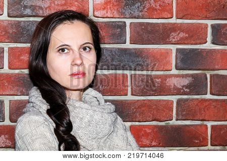 Portrait Of The Young Woman Up To Shoulders At A Wall