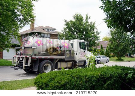JOLIET, ILLINOIS / UNITED STATES - JULY 18, 2017: A tank truck, belonging to Perfect Potty, Inc., is parked in Joliet's Historic Cathedral Area.