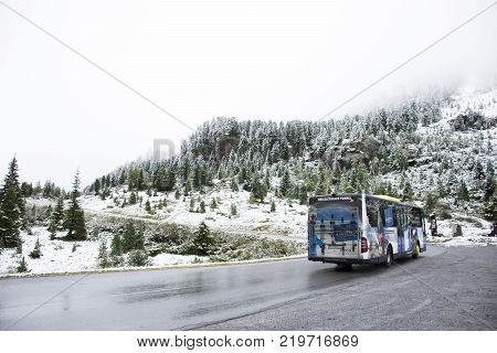 Bus driver driving buses bring travelers passenger go to top of mountain for travel and playing ski at Kaunergrat nature park on September 3 2017 in Tyrol Austria