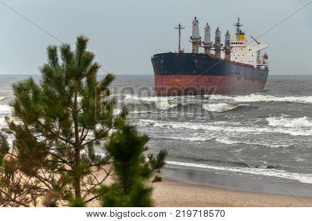 The storm threw the vessel aground near the coast