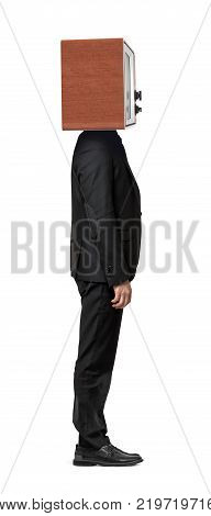 A single isolated businessman standing straight in a side view with a TV box on his head. Business and technologies. Retro TV. Corporate identity.