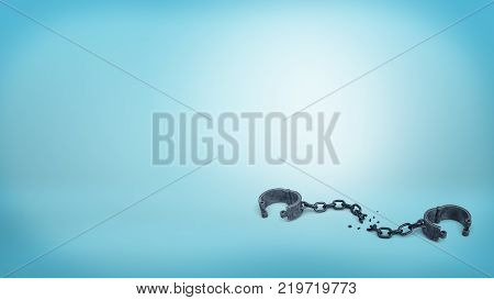 3d rendering of set of iron black handcuffs on a broken chain lying open on a blue background. Free of restrictions. Leave business limitations behind. Get free from credit burden.