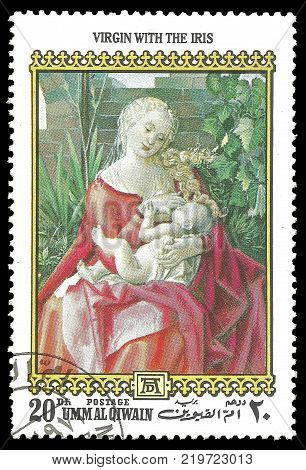 Umm Al Qiwain - circa 1972: Stamp printed by Umm Al Qiwain Color edition on 500th birthday of Albrecht Durer shows Painting Woman With The Iris circa 1972