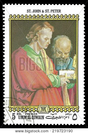 Umm Al Qiwain - circa 1972: Stamp printed by Umm Al Qiwain Color edition on 500th birthday of Albrecht Durer shows Painting St. John and St. Peter circa 1972