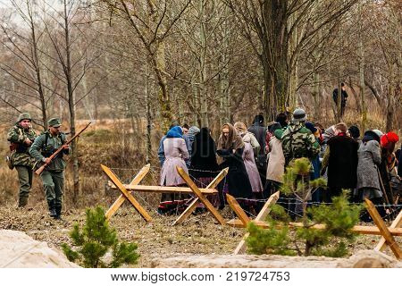 Gomel, Belarus - November 26, 2016: German soldiers guard the captives of civilians. Reconstruction of the Liberation of the City of Gomel