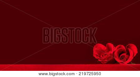 Two heart shaped red roses on fabric, background with copy space, Valentines day
