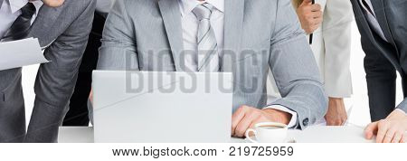 Business team working with laptop together