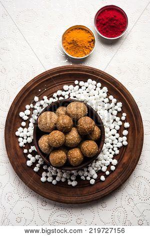 Tilgul or Til Gul with haldi Kumkum and halwa/chiranji or sugar balls for makar sankranti festival