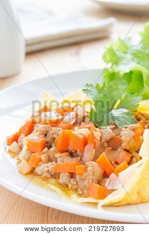 Stuffed omelet with carrot pork onion in white dish. Stuffed omelet food. Delicious stuffed omelet or fried eggs for breakfast. Stuffed omelet or fried eggs for health care people.
