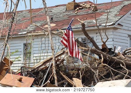 Tornados cause horrible destruction wherever they touch down. These folks fly the American flag as a symbol of their resolve to rebuild and not let nature get the better of them.