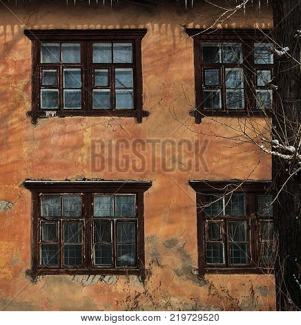 Fragment of an ancient building. Old architecture. Grunge building. Old window. Grunge window. Grunge architecture.