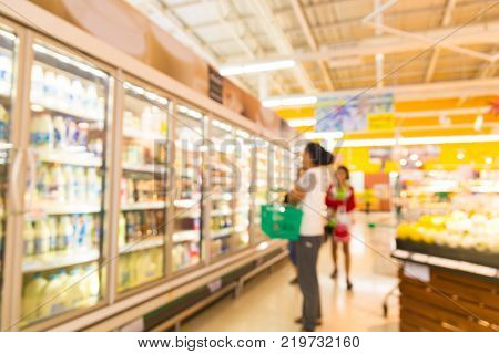 Blur Background of People Shopping in Hypermarket or Discount Convenience Store outlet at Frozen Food and Cold Drink Beverages Section as Modern Urban Lifestyle Concept