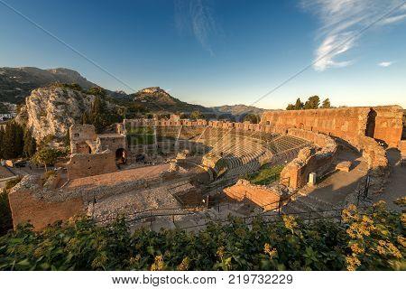 Ancient Greek Roman theater at sunset in Taormina town Messina Sicily island Italy (II century AD)