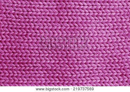 Pink vertical line knitting fabric texture background or knitted pattern background for design. Knitting or knitted. Knitting pattern or knitted pattern for design. Small pink knit texture or knit pattern.