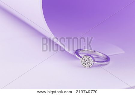 Wedding Or Engagement Silver Ring On Purple Background