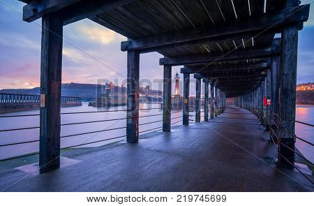 The lower deck of Whitby west pier looking towards Whitby Abbey and Church of Saint Mary North Yorkshire England