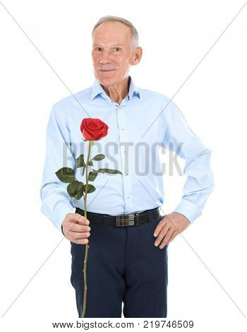 Attractive mature man with red rose on white background