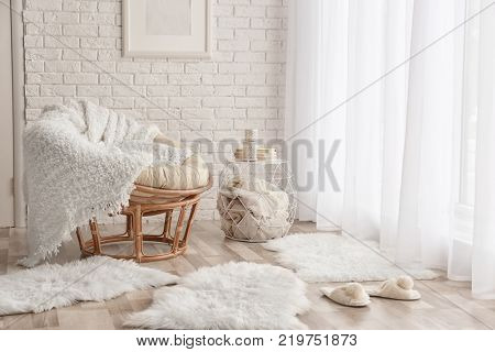 Modern room interior with lounge chair and soft fluffy carpets