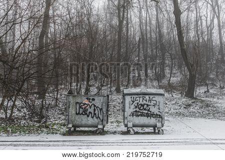 Garbage bin in forest. Abandoned garbage bins.