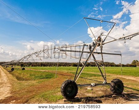 Center pivoting irrigation system in a field.