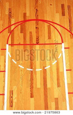 Basketball Key painted on hardwood floor in gymnasium