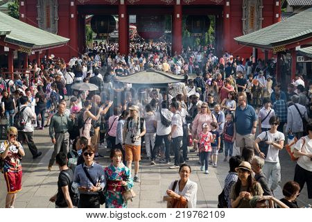 Tokyo - Japan, June 17, 2017; Tourists around Edo era Hozomon entrance of Sensoji, also known as Asakusa Kannon Temple, Asakusa