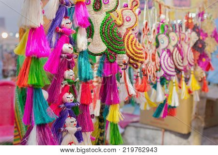 Handmade jute dolls colourful handicrafts on during Handicraft Fair in Kolkata - the biggest handicrafts fair in Asia.