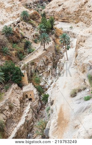 Near Mitzpe Yeriho Israel November 25 2017 : View from the window of the monastery of St. George Hosevit (Mar Jaris) on the dried river bed in Wadi Kelt near Mitzpe Yeriho in Israel