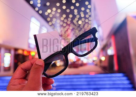 Boy holding 3D glasses and tickets ready to fun