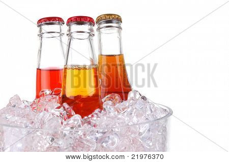 Three Soda Bottles in Glass Ice Bucket isolated over white