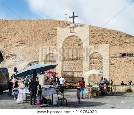 Near Mitzpe Yeriho Israel November 25 2017 : Bedouins sell souvenirs and sweets near the gate of the monastery of St. George Hosevit (Mar Jaris) in Wadi Kelt near Mitzpe Yeriho in Israel