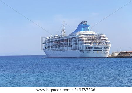 Big Modern Luxury Cruise Ship Docked At Marina Dock With Sea And Sky Background